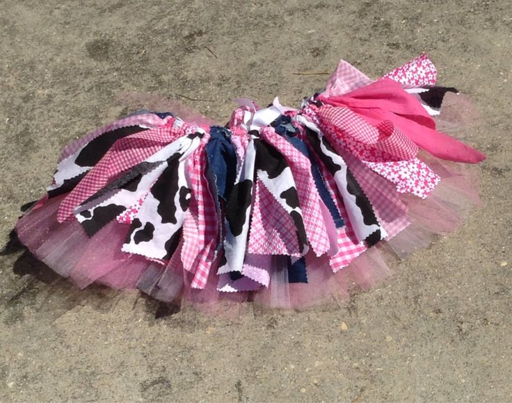 This fun cowgirl themed skirt will be the perfect finishing touch to any cowgirls Halloween costume or western birthday! Made with an extra underneath layer of tulle for extra fullness, pair with leggings and a tshirt and your little girl will be ready to giddy up! For easy adjustability, its made on a ribbon that can be tied into a pretty bow. Please note that patterns may vary slightly from the photo based on availability, if there is a drastic change to the appearance of the skirt well…