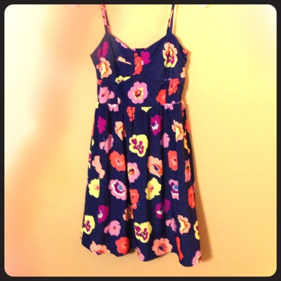 Navy floral sundress Navy blue sundress patterned with large pastel flowers. A bustier style top with a knee length flowing skirt. Old Navy Dresses