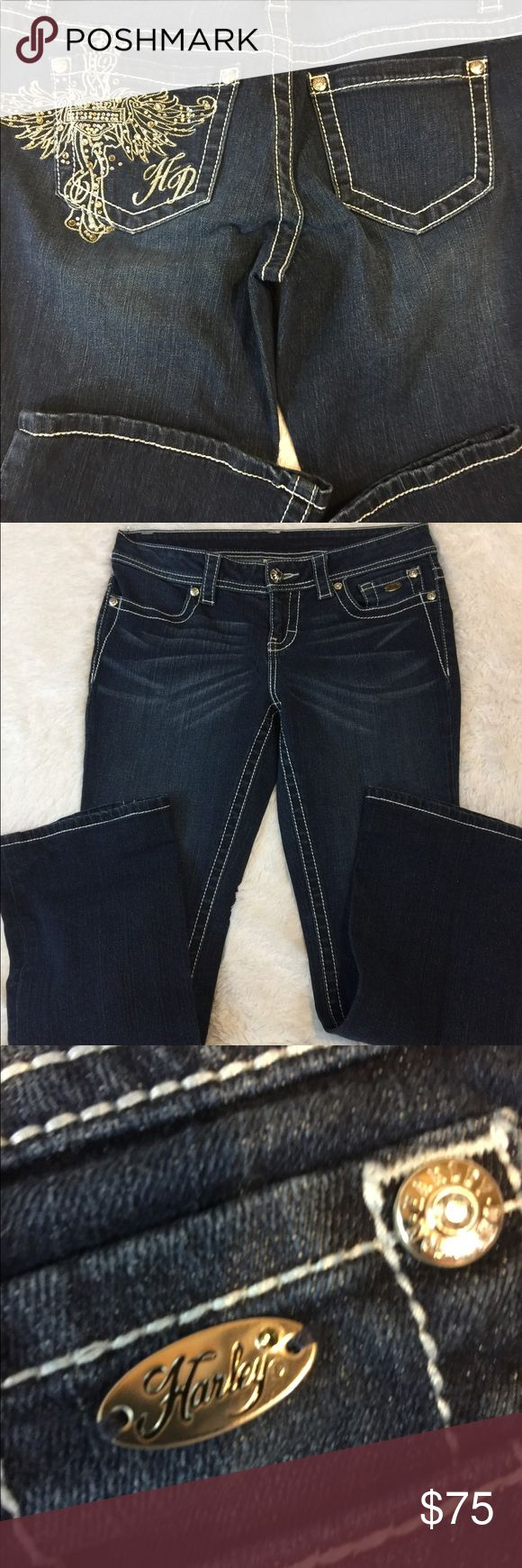 Harley Davidson Jeans Awesome Harley Davidson jeans, serious back pocket bling.  Size 6, W 33. L 29.. as you can see in the last picture these were hemmed, about 2-2.5 inches,so the inseam can be as long as 31-32 if hem is removed.  No pets/smoke closet. Harley-Davidson Jeans Boot Cut