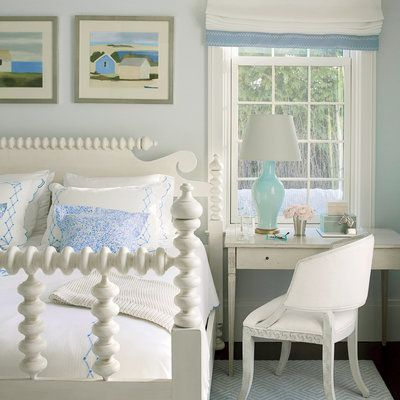 A timeless beach bedroom with soft, neutral colors and classic furnishings