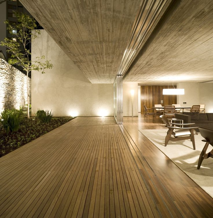Chimney House by Marcio Kogan / fine boardmarked concrete ceilings with matching timber floorboards/