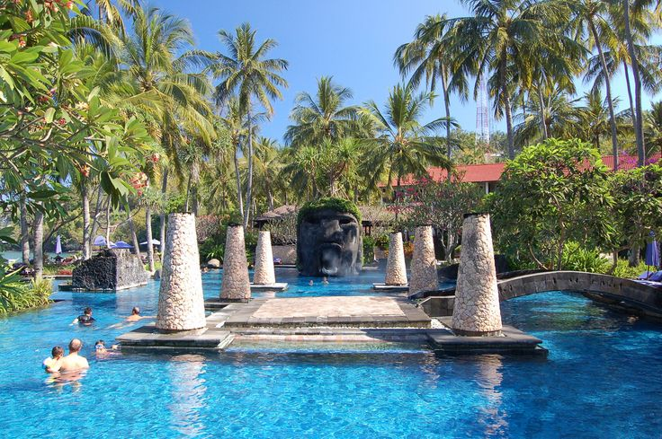 https://flic.kr/p/6VfEY9   Sheraton Senggigi   Last summer we spent 5 days at the Sheraton Hotel Senggigi on Lombok, Indonesia. The pool was just amazing with a huge head which you could climb from the back and slide out through the foggy mouth. At night the pillars where flares and illuminating the whole area with their flames. Some nights a live band was playing on the island in the middle of the pool.