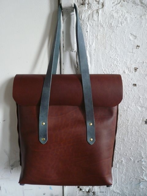 FLUX rich red-brown wax finished leather compact tote bag with straps for over the shoulder and a clip on strap for wearing cross-body. hand-stitched 9x5 interior pocket for separating keys
