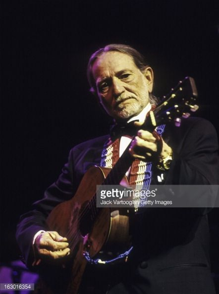 American country musician Willie Nelson, in formal attire, performs during a Valentine's Day concert at the Beacon Theater, New York, New York, February 14, 1995.