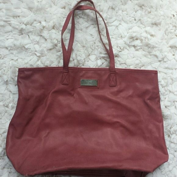 MANGO tote Original all weather resistant tote by MANGO. Shows normal signs of wearing but still in good shape. In a beautiful Fucsia color. Mango Bags Totes