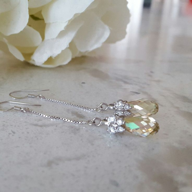 Beautiful Luminosity Drop Earrings in Sterling Silver and stunning Swarovski Crystal