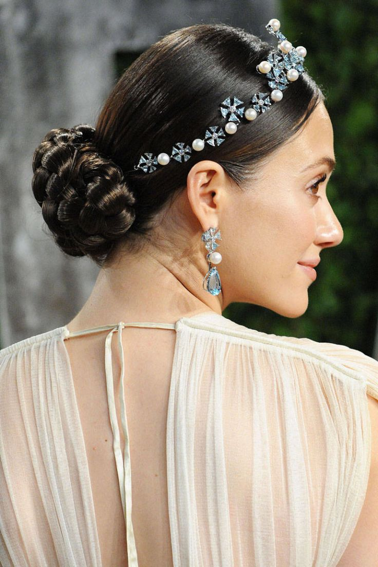 Inspired by Grace Kelly tiara-topped braided chignon imparts a polished elegance. Via Elle.com