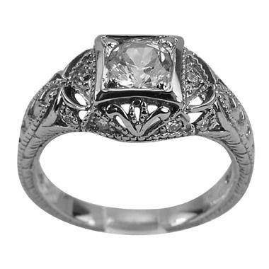 The engraving, the milgrain and the open filigree give this ring the distinct appearance of vintage diamond engagement rings.