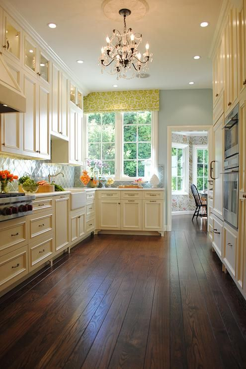 Cream cabinets brass hardware green arabesque tile for Kitchen with wood floors and white cabinets