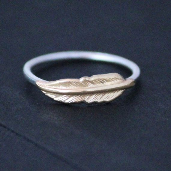 Hey, I found this really awesome Etsy listing at http://www.etsy.com/listing/125665766/feather-ring