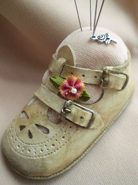I'm going to make me one of these with Sugar Plum's shoes.  I'll have memories of her wearing them as I sew her outfits!  baby shoe pin cushion..lovely to do with child's old shoe...cute gift for Grandma or favorite Aunt, too!
