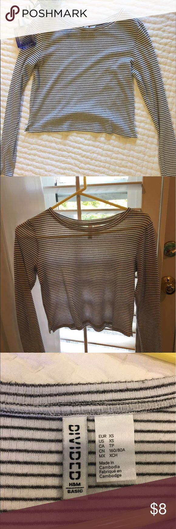 """H and M long sleeve crop top It is not too """"croppy"""" in length but it does show some skin. The stripes are black and white but suddle. The shirt has only been worn a couple times. No pilling or wear marks. In the picture with the window it shows that it can be see through but it is not too bad. The online picture is similar to the shirt I am selling here. Great with layers as well. Divided Tops Tees - Long Sleeve"""