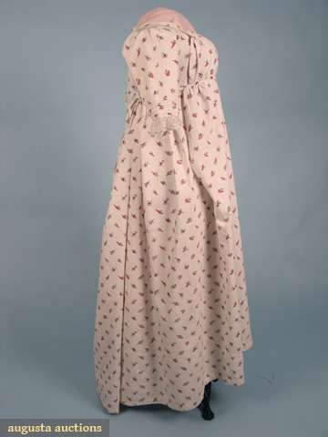 "Cotton print round gown, English, c1800;  White ground printed with small scattered red, pink, purple and blue leaves and flowers, gathered four band drop front bodice with shoulder buttons, center back ties, short tucked sleeves trimmed with lace, pair blue threads in selvedge, linen bodice and sleeve linings; Bust 30""-34"", waist adjustable, length 51""-55"""