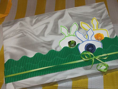 Wrap it up with a little whimsy non christmas easter gift wrap simple bunnys with paper rosettes tails using corrugated cardboard as ribbon negle Gallery