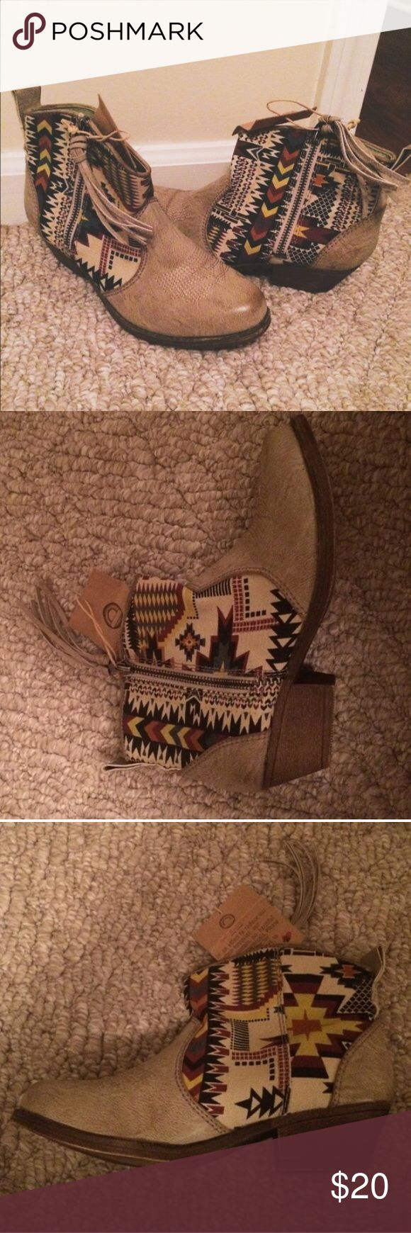 Aztec style ankle boot Cowboy boot style shoe with very low heel. Never worn! Big Buddha Shoes Ankle Boots & Booties