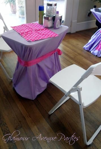 cover tray with vinyl table cloths and ribbon... easy peasy for stations. Hostess with the Mostess® - Pink and Purple Mobile Spa Party for Girls in Houston