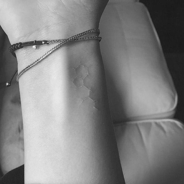 White ink molecule tattoo by Jon Boy