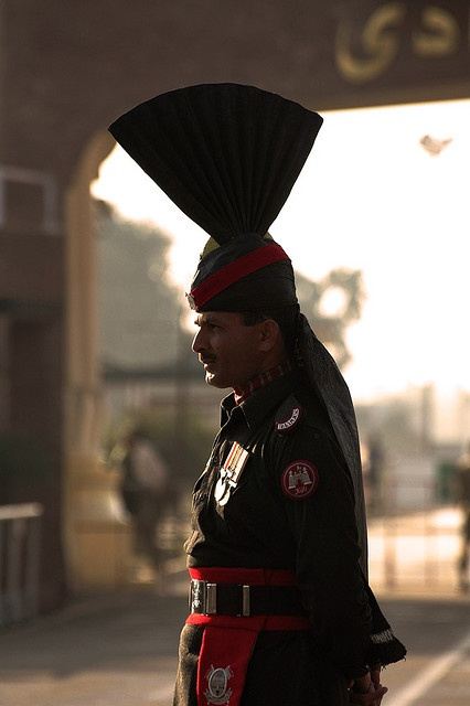 A tall handsome Pakistan Ranger at the Joint Check Post between India and Pakistan at Wagah. The Border Closing Ceremony at sunset is one of the most spectacular displays of drill. The border is manned by the Border Security Force (BSF) on the Indian Side and by the Rangers on the Pakistan side.