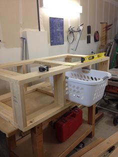 Homemade laundry pedestal with room for baskets.                                                                                                                                                     More