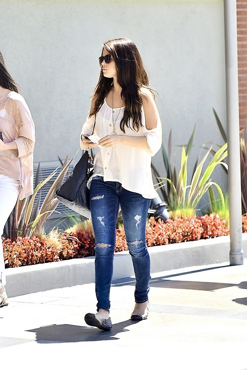Selena Gomez! love the ripped jeans!