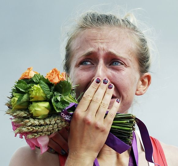 Anyone else see the fingers under the flowers?  That looks soooo weird with no accompanying arm!  (Great Britain's Katherine Copeland cries during the award ceremony for the lightweight women's rowing double sculls)
