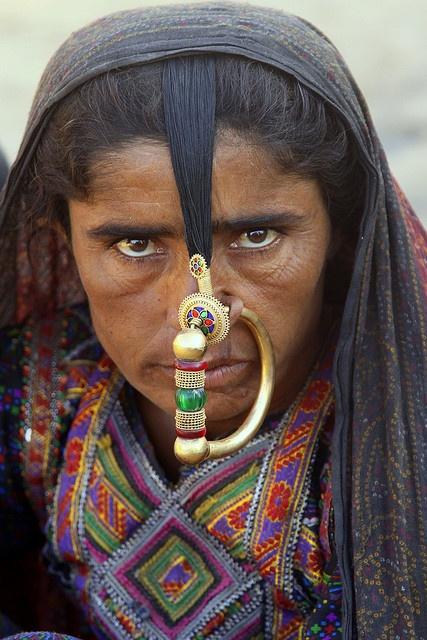 Asia | Dhaneta Jat woman wearing a traditional nose ring, Kutch District, Gujarat, India | © Walter Callens #piercing