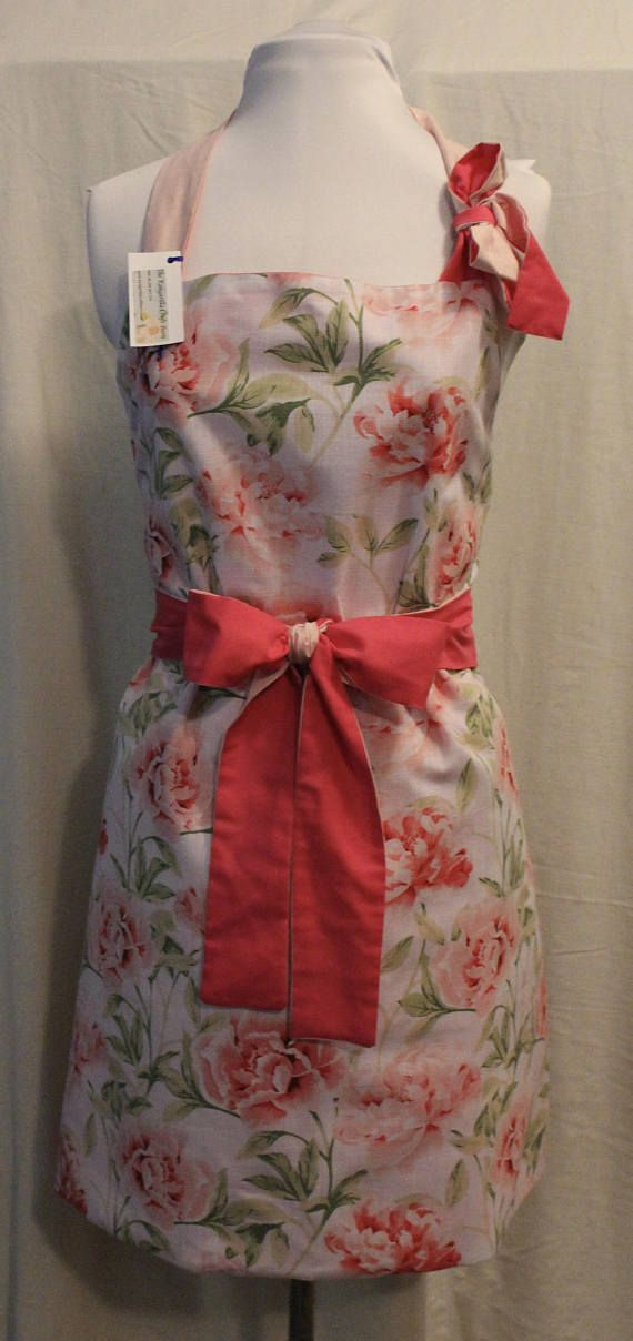 This pink floral apron is so special, we have hidden the pockets. Pockets are on each side of the apron, allowing you to view the full skirt without distraction. Extra long tie backs allow the apron to fit all sizes, 8 to 18+. You can tie it up at the back, or wrap the straps