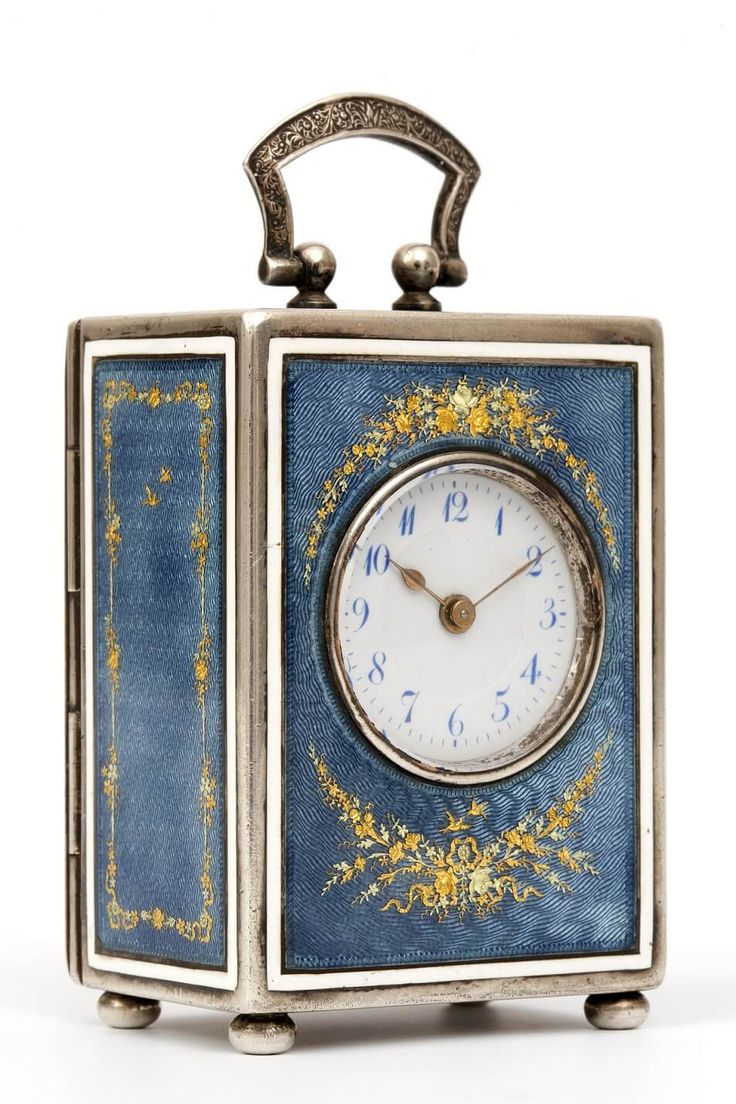 A Swiss silver miniature translucent enamel travel clock, circa 1920.