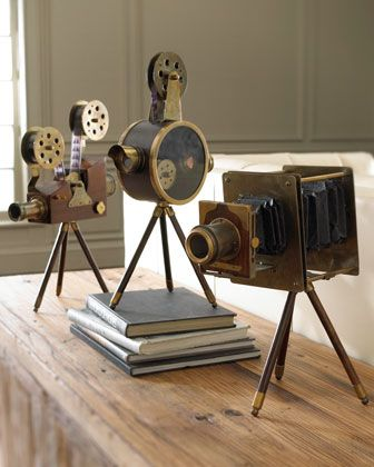 I would do this with real cameras. Awesome gift for a photography or film enthusiast!  Vintage Film Set at Horchow.