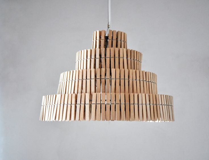 This Lamp is made with wooden clothes clips. Yes, those clips which we use for drying clothes! It makes a beautiful and soft shadow when it's turned on, because the light goes gently between the clips. Dimensions of the shade: 31 cm high x 43 cm wide. Handmade in Poland by Crea-Re