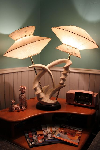I believe this beauty is a Moss Lamp.  Never heard of them, oh my, do a google image search!