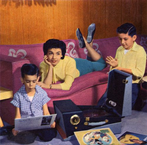 """Magazine picture in 1958 article in """"Walt Disney's Magazine"""": """"Annette listens to records in the living room with her brothers, Mike, 6, and Joey, 12"""