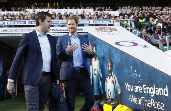 Prince Harry Photos Photos - Britain's Prince Harry, walks from the tunnel with Ben Calveley of the RFU during a visit to an England Rugby Squad training session at Twickenham Stadium on February 17, 2017 in London, England. In his new role as Patron of the Rugby Football Union (RFU), Prince Harry attended the England rugby team open training session. - Prince Harry Attends England Rugby Team Open Training Session