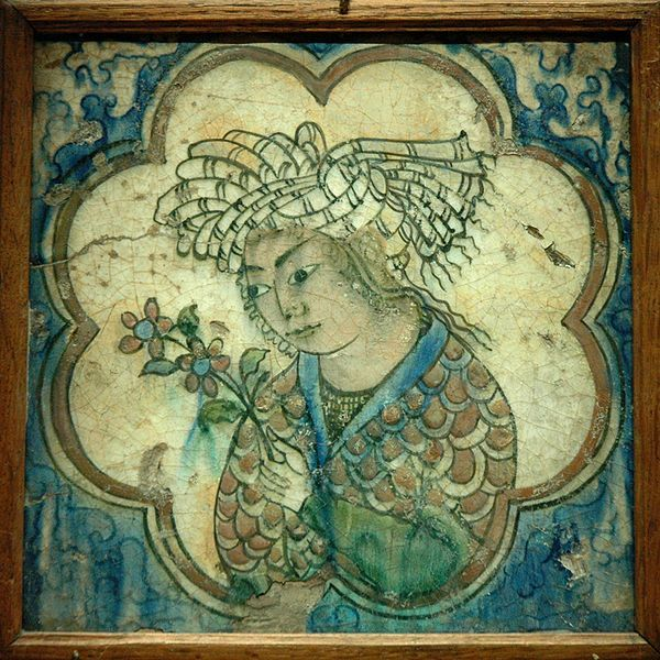 Tile with young man. Earthenware, painted on slip and under transparent glaze. Northwestern Iran, Kubacha ware, 17th century.