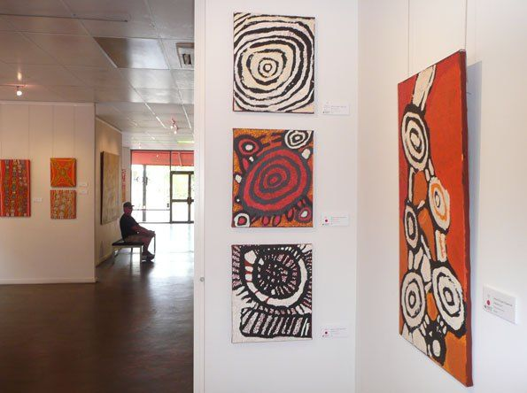 Johnny Yungut Tjupurrula solo show, 'Tjupurrulaku,' at the Papunya Tula Gallery, Alice Springs, 2013. Right, another view of the masterful Wilkinkarra, 2013, acrylic on linen, 91 x 46 cm. Center: three paintings also titled Wilkinkarra, 2013, acrylic on linen, 38 x 46 cm.