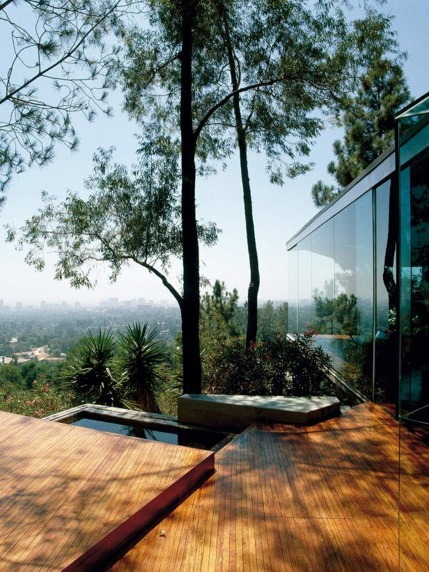 Broad Planes of Decking Lumber Used Around Pool  Broad planes of deck lumber are used around a reflection pool. Decks are an option for a garden design where otherwise there is no usable space. It can be tied to a building or a freestanding surfacing material.