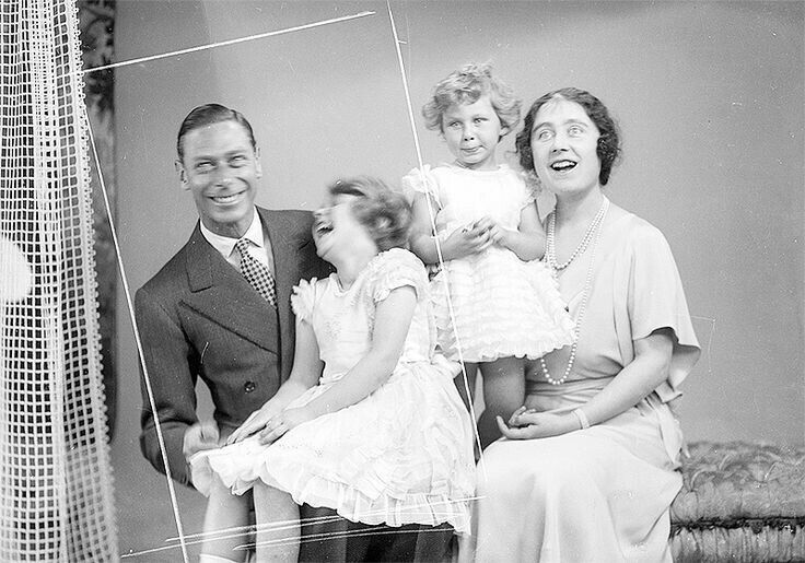A candid moment: George VI with his laughing daughter Princess Elizabeth (the Queen), Princess Margaret, and the Queen Mother