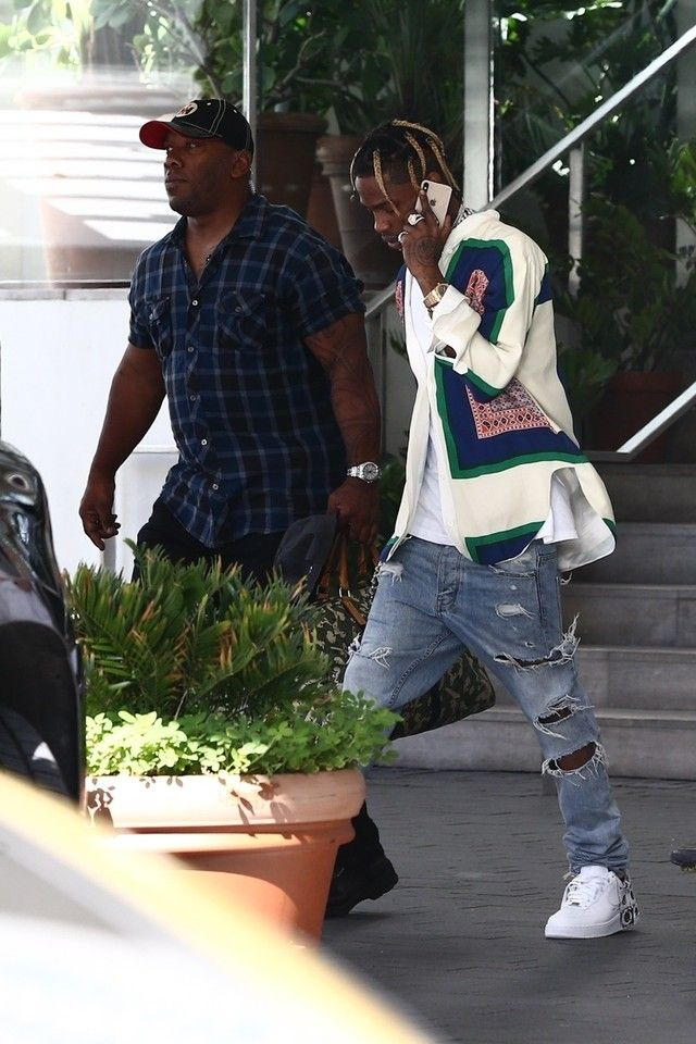 c3cadbe9 Travis Scott wearing Céline Spring 2011 Collection Silk Shirt, Nike Air  Force 1 Low Comme des Garcons