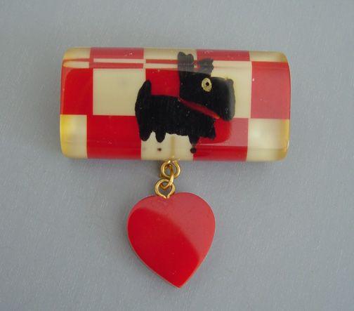 Shultz Bakelite Scotty dog brooch in red and cream checks.