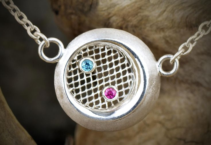 https://flic.kr/p/wTVk63   Pendent, Oval, Argentium Silver, with Fine Silver Screen 3mm Blue Topaz and 3mm Pink Tourmaline.psd