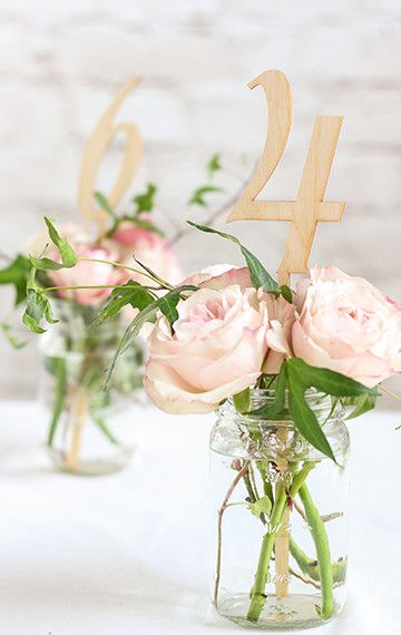 These wood table numbers are perfect for a rustic travel themed wedding