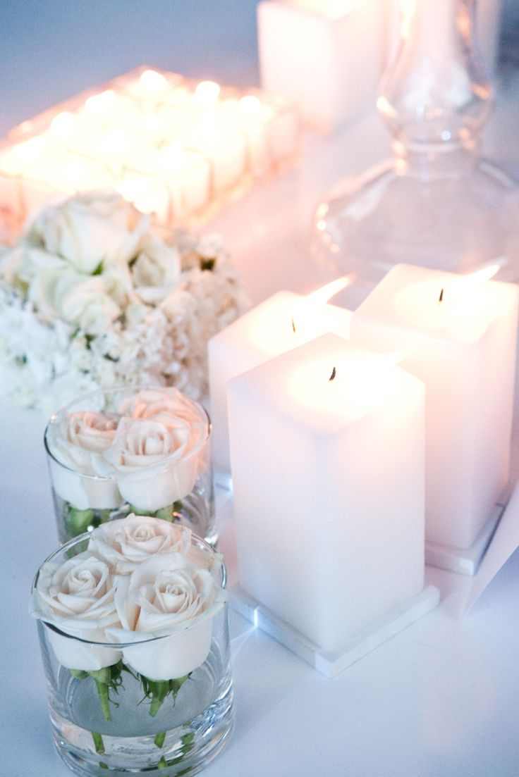 Velas blancas Iluminación Rosas