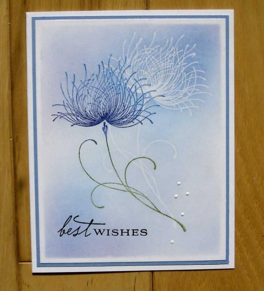 """By stiz2003 at Splitcoaststampers. Stamp Penny Black """"Dreamy"""" in VersaMark & emboss with clear powder. Then stamp it again, offset quite a bit to the left & down, in shades of blue with a green stem. Mask the edges to leave a white border. Sponge background in shades of blue. Remove masks. Add sentiment, blue mat, & white card base. White dots were made with Ranger enamel accents. Very pretty!"""
