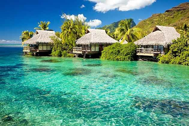 Bora Bora in Tahiti is surrounded by a picturesque lagoon and barrier reef. It is one of the charming islands of French Polynesia.