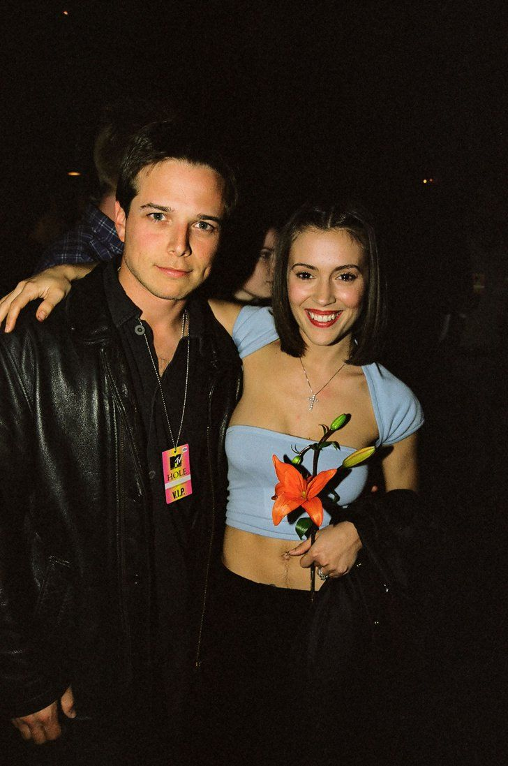 Pin for Later: 66 Celebrity Couples You Most Definitely Forgot About Alyssa Milano and Scott Wolf Alyssa and Scott fell in love in 1994.