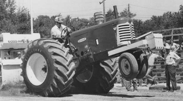 Jim Parker's super stock tractor pops a wheelie as the engine strains to move a heavy load in the 5,000 pound class tractor pull at the Indiana STate Fair.