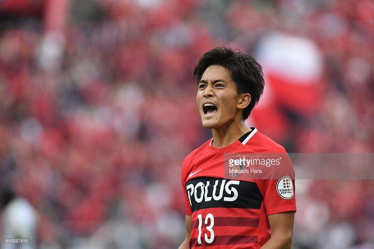 Toshiyuki Takagi #13 of Urawa Red Diamonds celebrates the third goal during the J.League match between Urawa Red Diamonds and Sanfrecce Hiroshima at the Saitama Stadium on September 25, 2016 in Saitama, Japan.