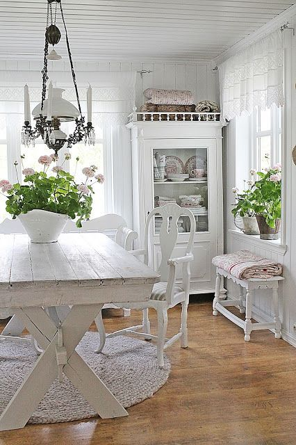 I love the clean bright look here. The table is way too tall for the chairs, but the look is wonderful!