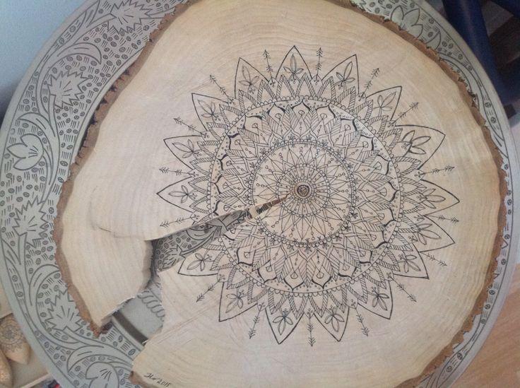 Mandalas. Pen drawing on wood.