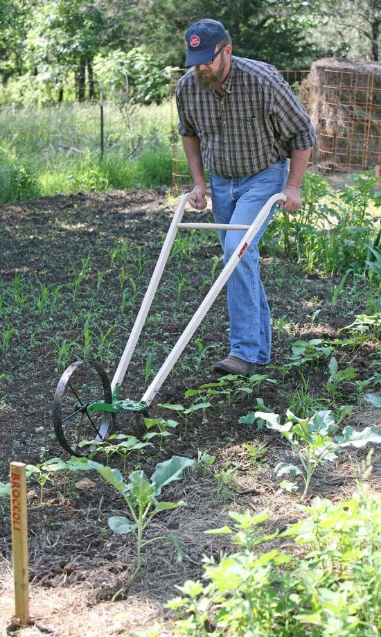Garden cultivator hoss tools wheel hoe is boss wheels for Agriculture garden tools